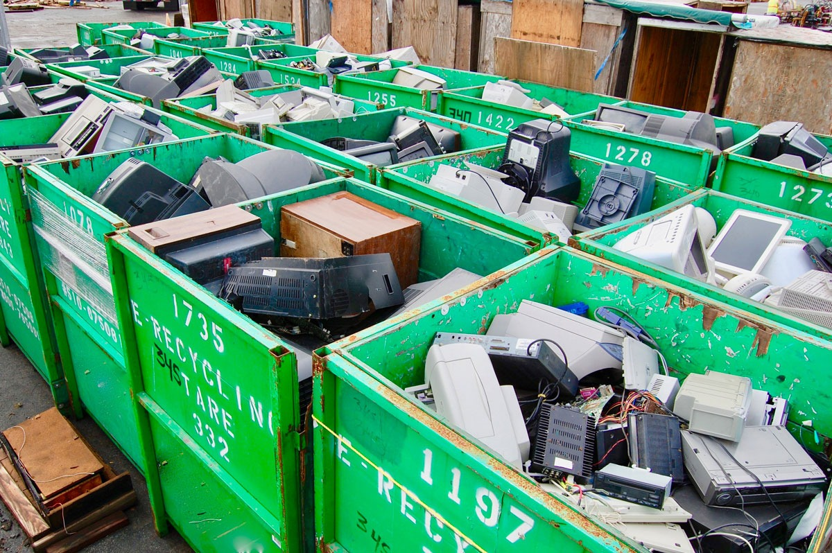 Containers filled with electronics showing the importance of recycling e waste